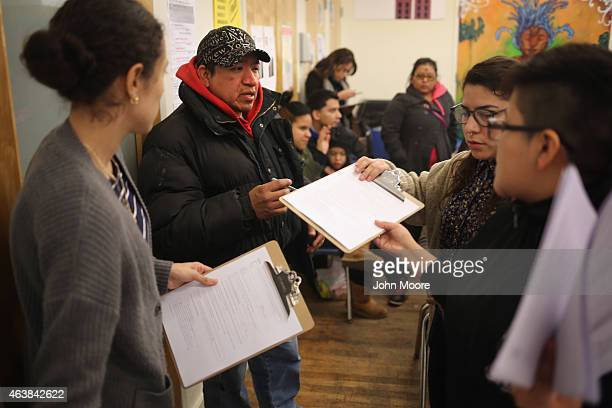 Immigrants fill out forms for Deferred Action for Childhood Arrivals at a workshop on February 18 2015 in New York City The immigrant advocacy group...