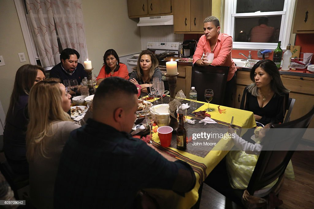 Immigrants from Central America and Mexico talk about President-elect Donald Trump at a Thanksgiving dinner on November 24, 2016 in Stamford, Connecticut. Family and friends, some of them undocumented immigrants, others on work visas and yet others now American citizens, came together to celebrate the American holiday with turkey and Latin American dishes. They expressed concern with the results of the U.S. Presidential election of president-elect Donald Trump, some saying their U.S.-born children fear the possibilty their parents will be deported after Trump's inauguration.