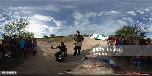 Immigrants from Central America are taken into custody by US Border Patrol agents on August 17 2016 in Roma Texas Thousands of Central American...