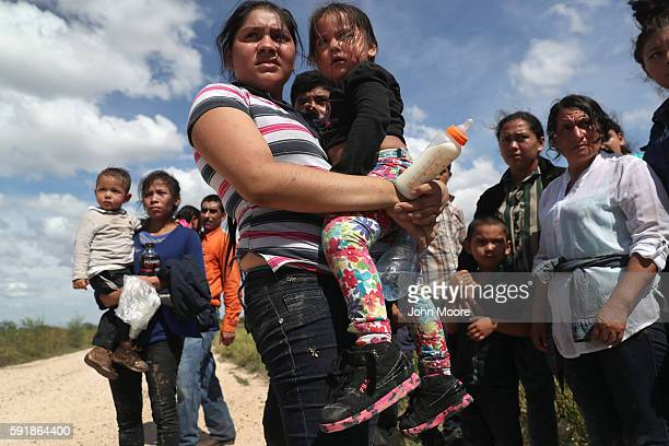 Immigrants from Central America await transport from the US Border Patrol on August 17 2016 in Roma Texas Thousands of Central American families...