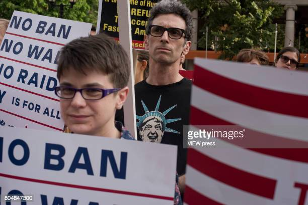 Immigrants join activists for an evening protest in Manhattan hours before a revised version of President Donald Trump's travel ban that was approved...