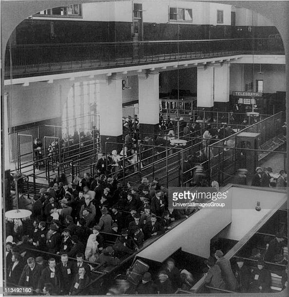 Immigrants just arrived in the USA from Europe waiting to be processed in the immigrant building Ellis Island New York