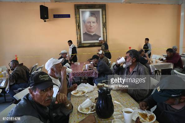 Immigrants many of them deportees from the United States eat breakfast at a soup kitchen on September 24 2016 in Tijuana Mexico The center called the...