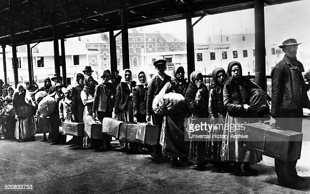 Immigrants on Ellis Island reception centre New York City 1902