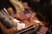 Immigrants prepare to take the oath of allegiance to the United States during a naturalization ceremony on July 9 2014 in New York City Seventyfive...