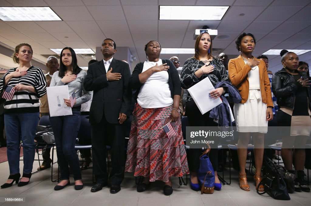 Immigrants stand for the national anthem before becoming American citizens at a naturalization ceremony held at the U.S. Citizenship and Immigration Services (USCIS), office on May 17, 2013 in New York City. One hundred and fifty immigrants from 38 different countries became U.S. citizens at the event. Some 11 million undocumented immigrants living in the U.S. stand to eventually gain American citizenship if Congress passes immigration reforms currently being negotiated in Washington D.C.