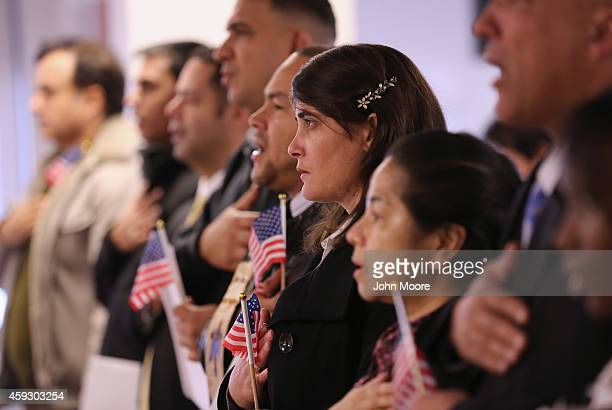 Immigrants take oath of citizenship to the United States on November 20 2014 in Newark New Jersey Sixty immigrants from 25 countries became American...