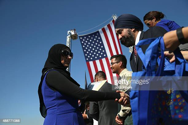 Immigrants take part in a naturalization ceremony at Liberty State Park on September 17 2015 in Jersey City New Jersey The group representing 30...