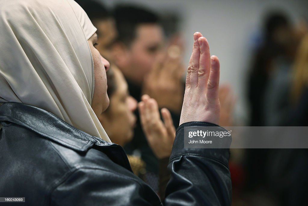 Immigrants take the oath of allegiance to the United States during a naturalization ceremony at the district office of U.S. Citizenship and Immigration Services (USCIS) on January 28, 2013 in Newark, New Jersey. Some 38,000 immigrants became U.S. citizens at the Newark office alone in 2012.