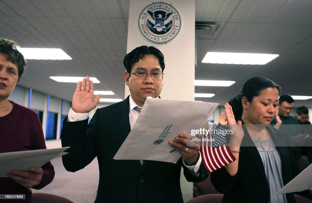 Immigrants take the oath of allegiance to the United States during a ceremony at the district office of U.S. Citizenship and Immigration Services (USCIS) on January 28, 2013 in Newark, New Jersey. Some 38,000 immigrants became U.S. citizens at the Newark office alone in 2012.