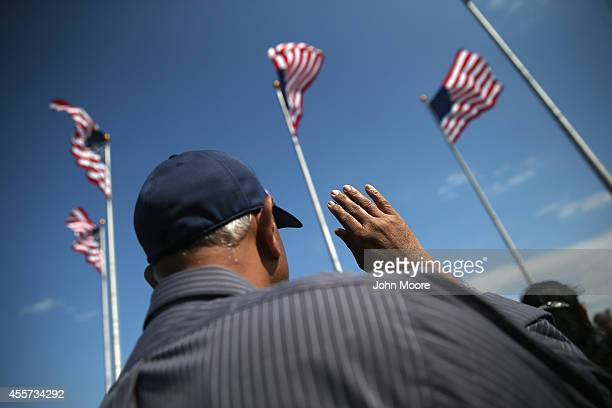 Immigrants take the oath of citizenship to the United States at a naturalization ceremony at Liberty State Park on September 19 2014 in Jersey City...