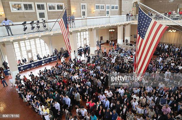 Immigrants take the oath of citizenship to the United States in the Great Hall of Ellis Island on September 16 2016 in New York City The ceremony...