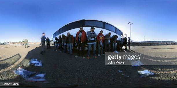Immigrants wait to be deported across an international bridge by US border agents into Mexico on March 14 2017 from Hidalgo Texas The Trump...