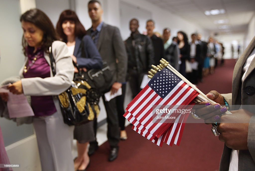 Immigrants wait to become American citizens ahead of a naturalization ceremony at the U.S. Citizenship and Immigration Services (USCIS), office on May 17, 2013 in New York City. One hundred and fifty immigrants from 38 different countries became U.S. citizens at the event. Some 11 million undocumented immigrants living in the U.S. stand to eventually gain American citizenship if Congress passes immigration reforms currently being negotiated.