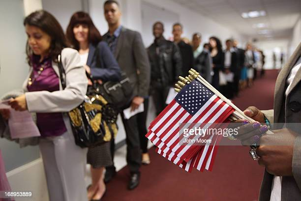 Immigrants wait to become American citizens ahead of a naturalization ceremony at the US Citizenship and Immigration Services office on May 17 2013...