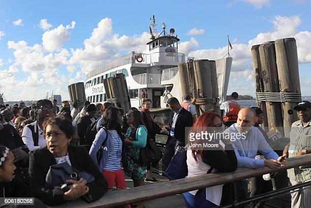 Immigrants wait to ride in a ferry to Ellis Island for a naturalization ceremony on September 16 2016 in New York City The ceremony marked US...