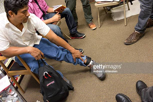 Immigration activists meet with people seeking political asylum to help them with the legal process at a Manhattan church on September 27 2016 in New...