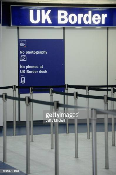 Immigration and border control signs at Edinburgh Airport on February 10 2014 in Edinburgh Scotland A recent survey has shown that Scottish people...
