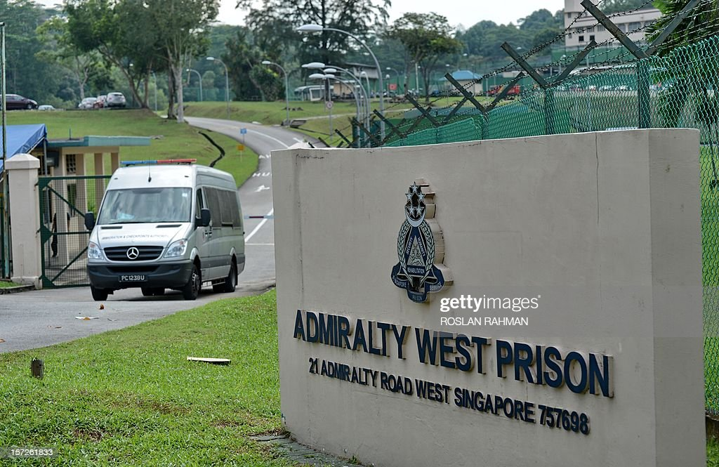 A Immigration and Checkpoint Authority van (L) leaves the Admiralty West prison where mainland Chinese SMRT bus drivers were taken in Singapore on December 1, 2012. About 25 SMRT bus drivers from China was taken to the prison on December 1, reported a local website after a recent strike in Singapore where four were charged in court. AFP PHOTO/ROSLAN RAHMAN