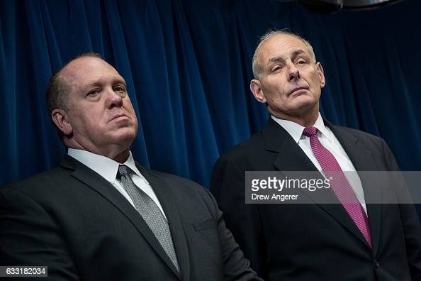 US Immigration and Customs Enforcement Acting Director Thomas Homan and Secretary of Homeland Security John Kelly listen to questions during a press...