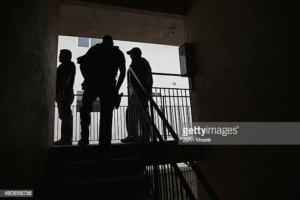 S Immigration and Customs Enforcement agents arrive to detain an immigrant on October 14 2015 in Los Angeles California ICE agents said the immigrant...