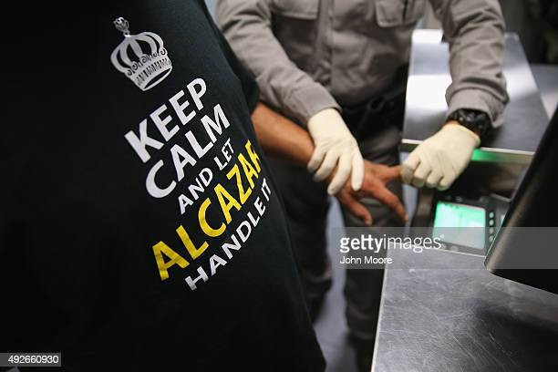 S Immigration and Customs Enforcement agents fingerprint a detained immigrant at an ICE processing center on October 14 2015 in Camarillo California...