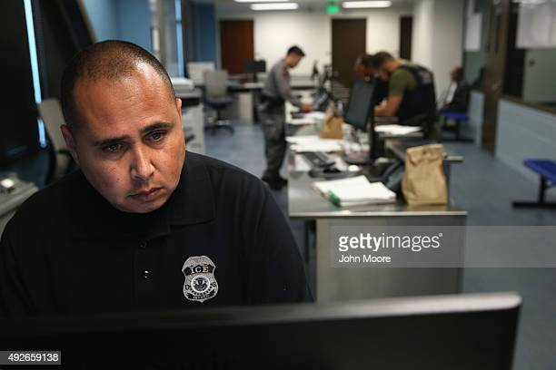 S Immigration and Customs Enforcement agents work to inprocess immigrants detained at an ICE center on October 14 2015 in Camarillo California ICE...