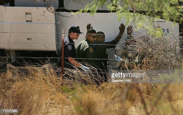 S Immigration and Customs Enforcement and Border Patrol agents detain a man caught after illegally crossing the border with Mexico June 16 2006 in...