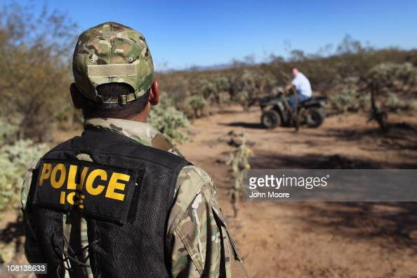 US Immigration and Customs Enforcement tactical officer Kevin Carlos watches as a fellow officer drives off a confiscated ATV seized with some 500...
