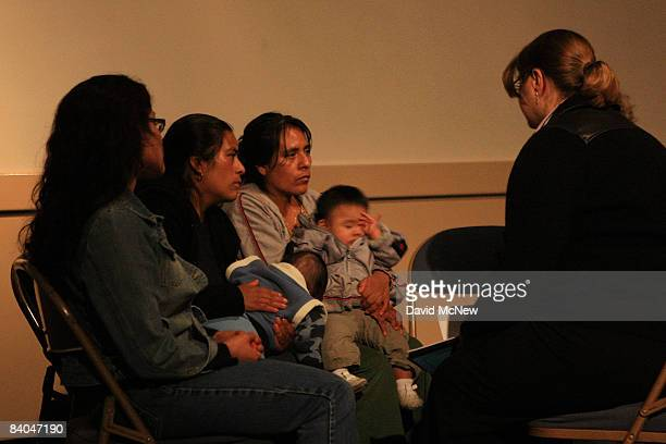 Immigration attorneys give free consultations to immigrants in a dimlylit room darkened by a stormrelated electrical power outage as immigrants are...