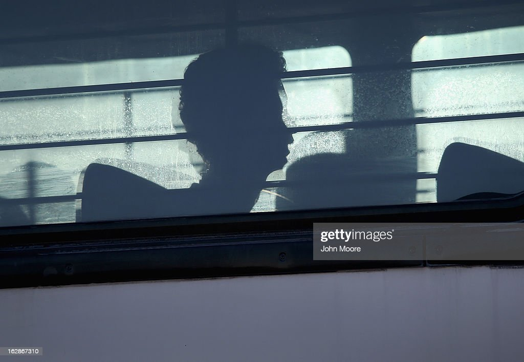 Immigration detainees from Honduras arrive by bus to board a deportation flight to San Pedro Sula, Honduras on February 28, 2013 in Mesa, Arizona. U.S. Immigration and Customs Enforcement (ICE), operates 4-5 flights per week from Mesa to Central America, deporting hundreds of undocumented immigrants detained in western states of the U.S. With the possibility of federal budget sequestration, ICE released 303 immigration detainees in the last week from detention centers throughout Arizona. More than 2,000 immigration detainees remain in ICE custody in the state. Most detainees typically remain in custody for several weeks before they are deported to their home country, while others remain for longer periods while their immigration cases work through the courts.