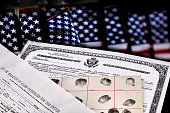 Certificate of US Citizenship, fingerprint card, Declaration of Intention and Passenger Manifest documents with American Flags