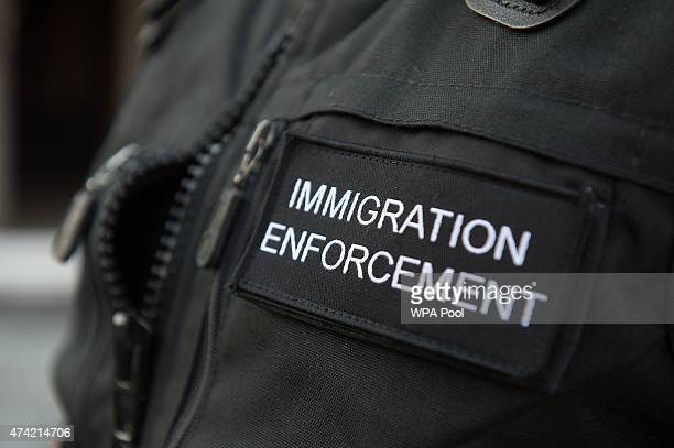 Immigration enforcement officers raid a home in Southall on May 21 2015 in London England Despite pledging in 2010 to reduce migration numbers to...