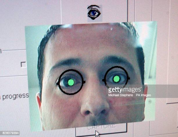 Immigration Minister Tony McNulty tries out the Iris Recognition Immigration System at Heathrow Airport London Friday March 10 2006 at the launch of...