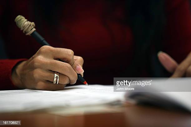 Immigration officer Doris Rodriguez scores a citizenship test on February 14 2013 in Tampa Florida The US Citizenship and Immigration Service in...