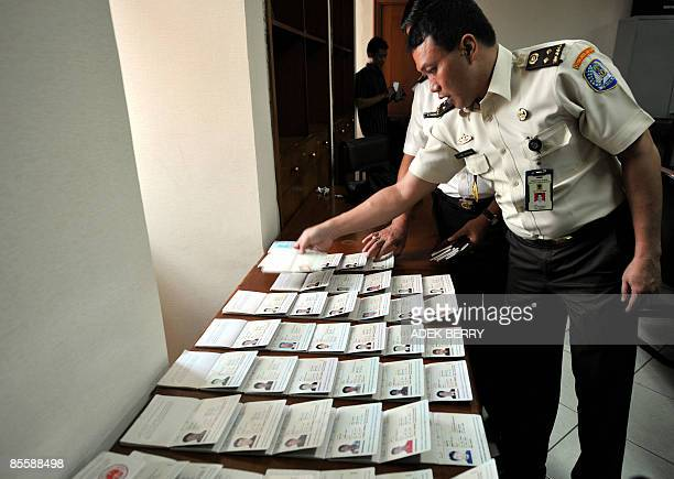Immigration officers display seized passports after the arrest of Yusuf Karim alias Joe Joshua a 57yearold US man born in Afghanistan in Jakarta on...