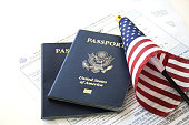 US Passports with flag and renewal forms