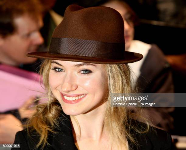 Imogen Poots arrives for a performance of 'The Umbrellas of Cherbourg' at the Gielgud Theatre in Soho central London