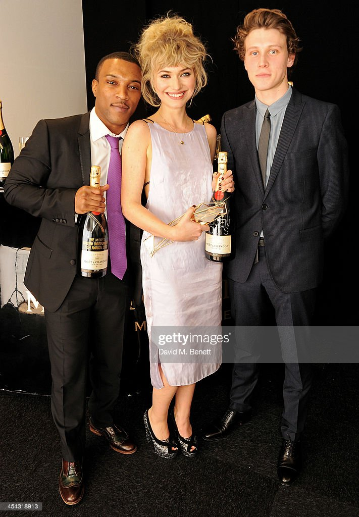 Imogen Poots winner of Best Supporting Actress for 'The Look of Love' poses with presenters Ashley Walters and George MacKay at the Moet British...