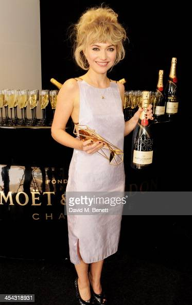 Imogen Poots winner of Best Supporting Actress for 'The Look of Love' poses backstage at the Moet British Independent Film Awards 2013 at Old...