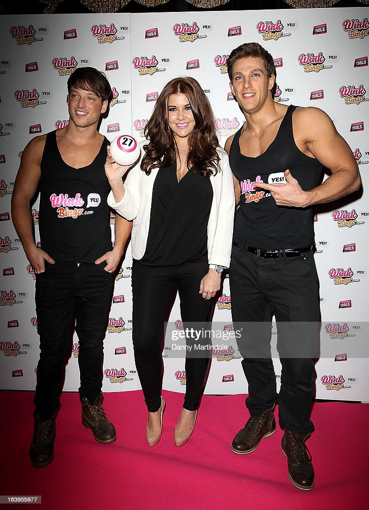 <a gi-track='captionPersonalityLinkClicked' href=/galleries/search?phrase=Imogen+Thomas&family=editorial&specificpeople=1963481 ng-click='$event.stopPropagation()'>Imogen Thomas</a> (C) poses with male strippers as she attends the Wink Bingo Celebrity Female Take Over on March 18, 2013 in London, England.