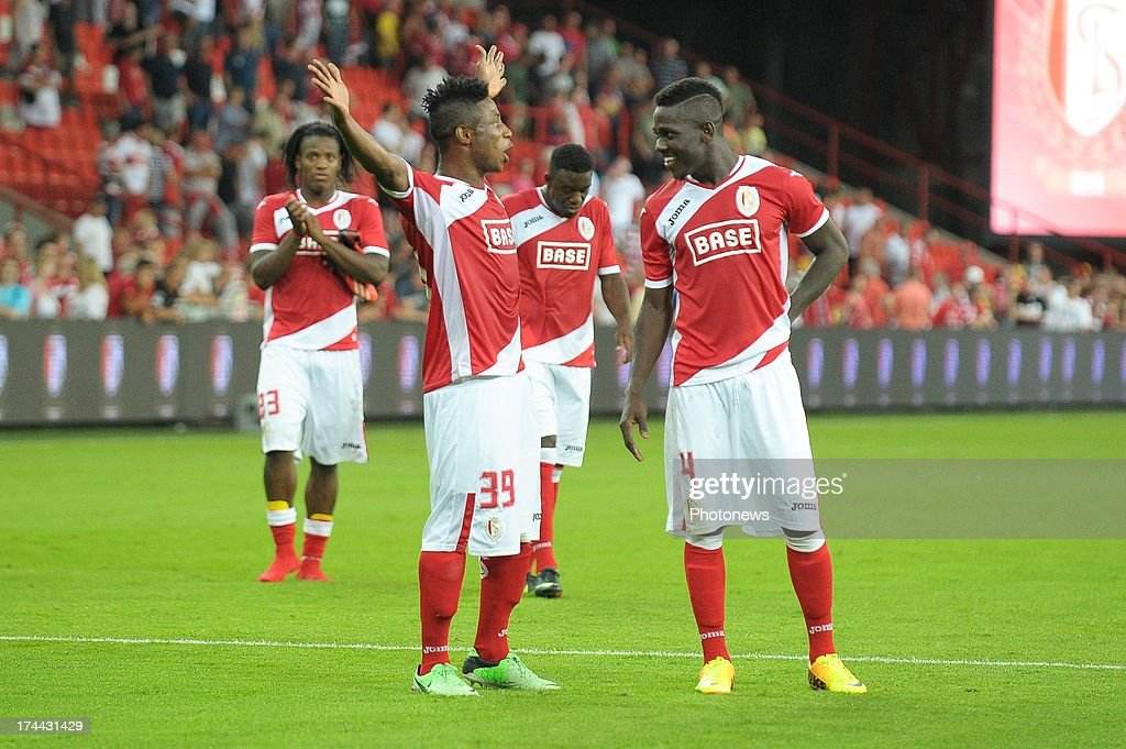 Imoh Ezekiel #39 and Daniel Opare #4 of Standard de Liege talk during a break in the action of their Europa League match against KR Reykjavik on July 25 , 2013 in Liege, Belgium.