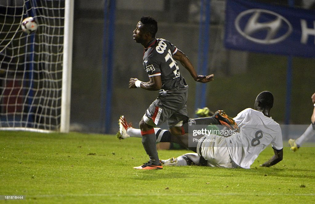 Imoh Ezekiel of Standard Liege celebrates with teammates after scoring pictured during the Cofidis Cup match between White Star and Standard of Liege on september 25 , 2013 in Woluwe, Belgium.