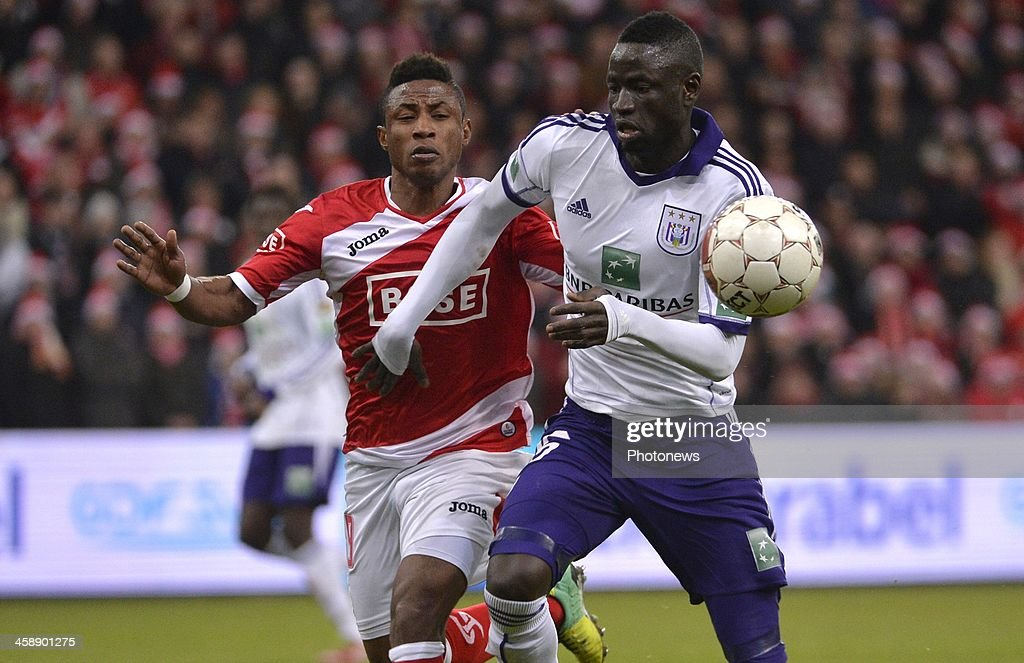 Imoh Ezekiel of Standard Liege - Kouyate Cheikhou of Rsc Anderlecht during the Jupiler League match between Standard Liege and RSC Anderlecht on December 22, 2013 in Liege, Belgium.