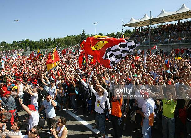 Fans cheer German Ferrari driver Michael Schumacher after the formula one San Marino Grand Prix race at the Imola race track Italy 23 April 2006...