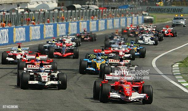 German Ferrari driver Michael Schumacher leads the pack at the start of the formula one San Marino Grand Prix race at the Imola race track Italy 23...