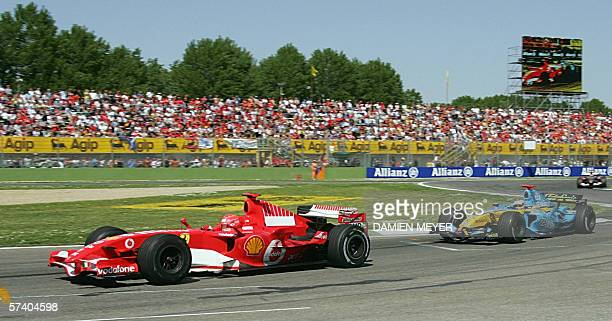 German Ferrari driver Michael Schumacher steers his car ahead of Spanish Renault driver Fernando Alonso during the formula one San Marino Grand Prix...