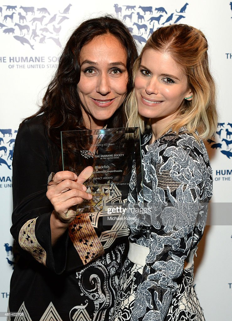 Impact award winner Filmmaker Gabriela Cowperthwaite (L) and actress Kate Mara attend the Humane Society of The United States 60th Anniversary Gala at The Beverly Hilton Hotel on March 29, 2014 in Beverly Hills, California.