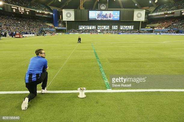 MONTREAL PQ NOVEMBER 22 Impact grounds crew race to paint over lines as they installed the box to FIFA dimensions rather than MLS Toronto FC plays...