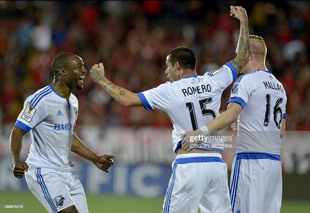 Impact of Montreal players Reo Coker Andres Romero and Callum Mallace celebrate a goal against Liga Deportiva Alajuelense during their Concacaf...